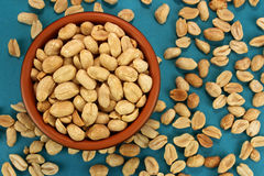 Roasted Salted Peanuts In Bowl On Blue Background Top View Royalty Free Stock Images