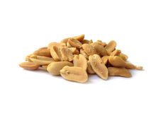 Roasted salted peanuts. A neat pile of roasted salted peanuts on a white background Royalty Free Stock Photo