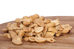Roasted salted peanuts on the wooden board Royalty Free Stock Photo