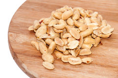 Roasted salted peanuts on the wooden board Royalty Free Stock Photography