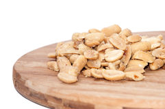 Roasted salted peanuts on the wooden board Stock Photo