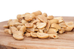 Roasted salted peanuts on the wooden board Stock Photos