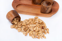 Roasted salted peanuts and wooden bowls for serving Stock Images