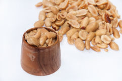 Roasted salted peanuts and wooden bowls for serving Stock Photo