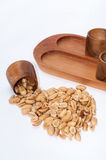 Roasted salted peanuts and wooden bowls for serving Royalty Free Stock Photo