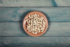 Roasted salted peanuts on wooden table Royalty Free Stock Image