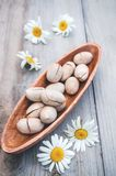 Roasted and salted pecan nuts on rustic wooden background. Copy space.  royalty free stock photo