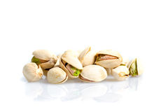 Roasted and salted pistachio nuts with shell with reflexion on w. Roasted and salted pistachio nuts with shell with reflexion isolated on white background Stock Photography