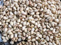 Roasted and salted pistachio seeds stock images