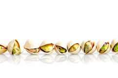 Roasted and salted pistachio with shell in line and reflexion is Stock Photo