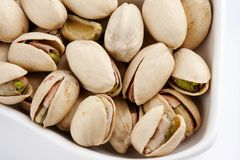 Roasted and salted pistachios Stock Images