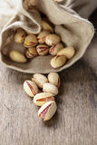 Roasted and salted pistachios pour out of the bag Royalty Free Stock Image