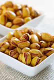 Roasted salted pistachios in a square bowls royalty free stock image