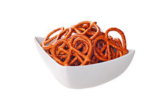 Roasted and salted pretzels on a white bowl, white background Royalty Free Stock Photo