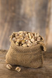 Roasted salty pistachios nuts in burlap bag Royalty Free Stock Photography