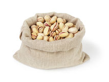 Roasted salty pistachios nuts in sack bag Royalty Free Stock Photo