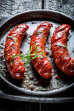 Roasted sausage with fresh herbs Royalty Free Stock Images