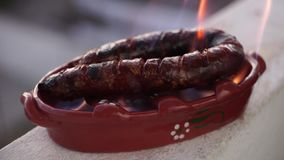 Roasted sausage prepared in special clay pot with alcohol, Portugal stock video