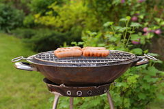 Roasted sausages on a barbecue grill outdoors Stock Photography