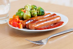 Roasted sausages with broccoli Royalty Free Stock Photography