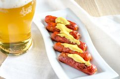 Roasted sausages with glass of beer Stock Images