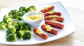 Roasted sausages with mustard sauce Stock Photography
