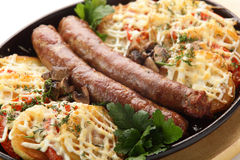 Roasted sausages with potato Royalty Free Stock Images