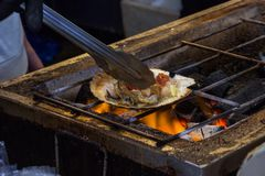 The roasted scallops seasoning with garnish japanese style. Sele Stock Photos