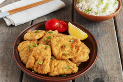 Roasted schnitzel chop escalope with lemon tomato rice Royalty Free Stock Images