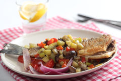 Roasted sea bass with vegetables Stock Image