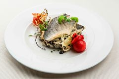 Roasted sea bass. With white and wild rice royalty free stock photo
