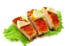 Roasted sea fish with lemon Royalty Free Stock Image