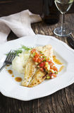 Roasted seabass fillets with sauce Las Vegas Salsa and mashed potato Royalty Free Stock Images