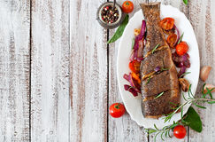 Roasted seabass with vegetables Stock Photography