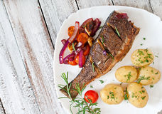 Roasted seabass with vegetables Royalty Free Stock Images