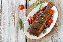 Roasted seabass with vegetables Stock Image