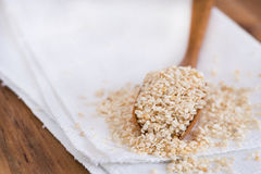 Roasted sesame seeds on a wooden spoon Stock Photo