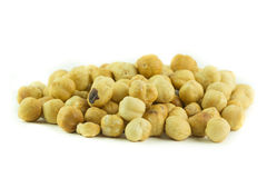 Roasted shelled peanuts on white Stock Images