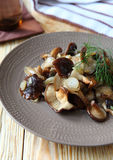 Roasted shiitake mushrooms with onions Royalty Free Stock Image