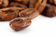 Roasted shiny grains of coffee Royalty Free Stock Photography