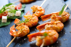 Roasted shrimp starter on skewer. Stock Images