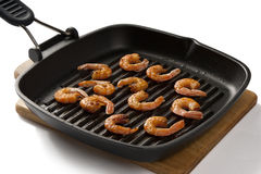Roasted shrimps. Some roasted shrimps on the grill black pan Royalty Free Stock Photo
