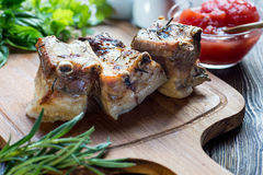 Roasted sliced barbecue pork ribs, focus on sliced meat Royalty Free Stock Images