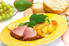 Roasted slices of pork with broccoli Royalty Free Stock Images