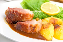 Roasted Slices Of Pork With Lettuce And Fried Pota Royalty Free Stock Photos