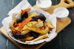 Roasted slices spiced vegetables Royalty Free Stock Images