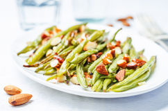 Roasted snap green beans with almond Stock Photos
