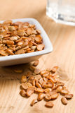 Roasted soya beans on wooden table Stock Images