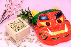 Roasted soybeans and holly and plum blossoms. Stock Photo