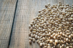 Roasted soybeans on wooden background Royalty Free Stock Images